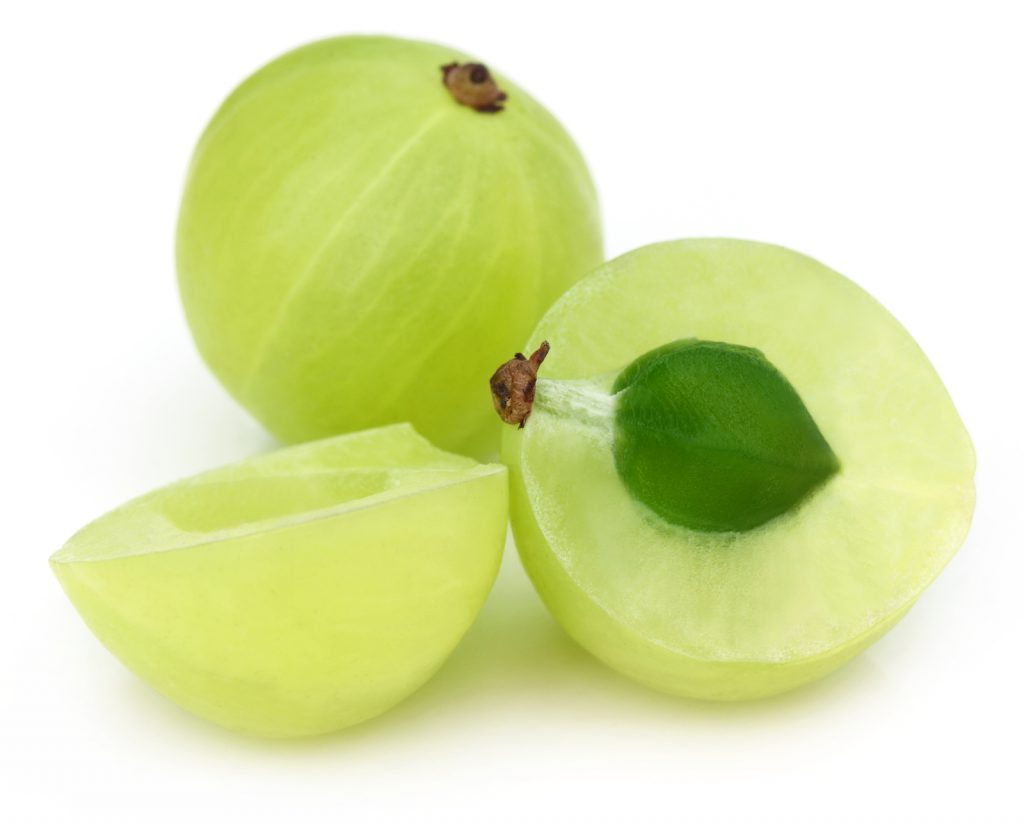 Sliced amla with selective focus over white background